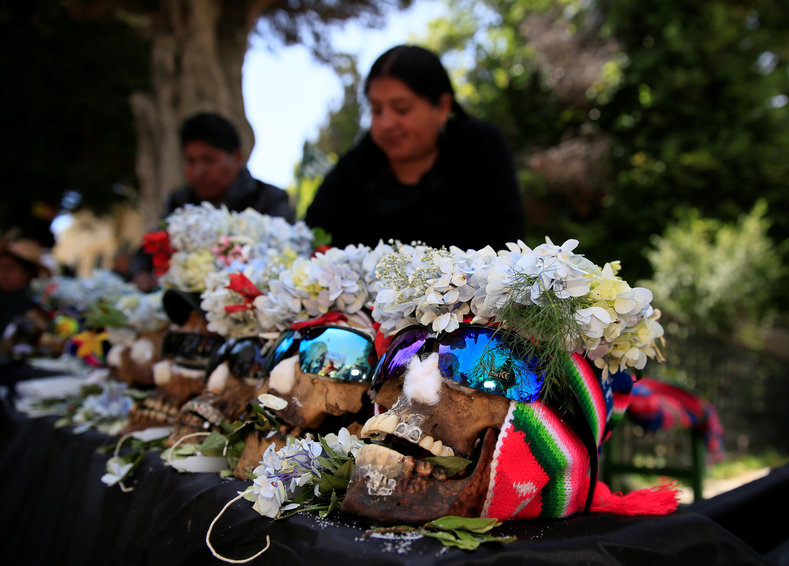 "A woman in La Paz, Bolivia, prepares ""ñatitas"" to be taken to the cemetery on Day of Skulls."