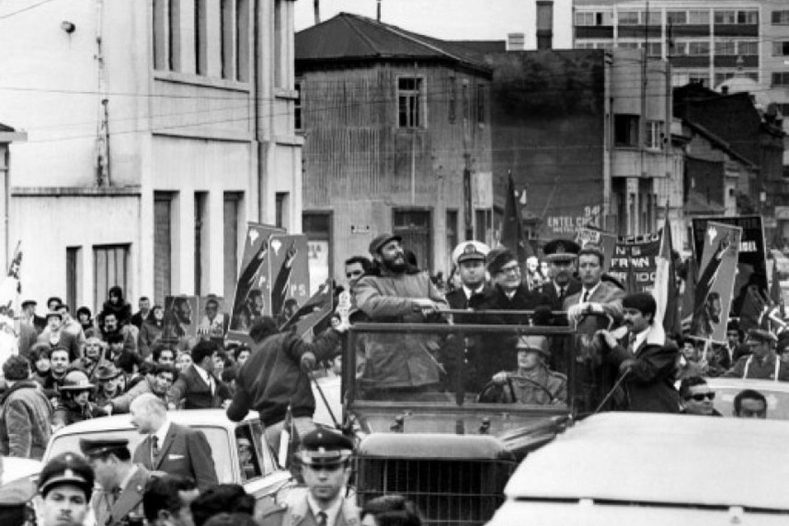 Fidel Castro parading through the streets of Chile with President Salvador Allende in 1971.