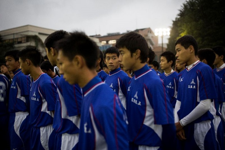Students attend a football training session at Korean High in Tokyo.