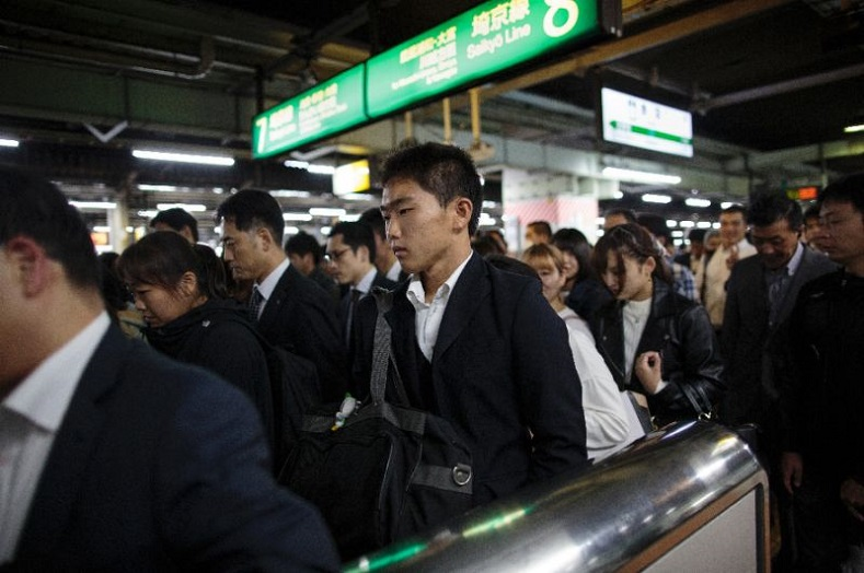 Korean students take the Tokyo subway to get home from school.