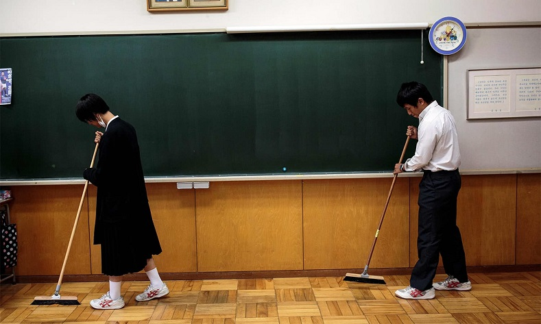 Students clean the classroom after an exam at Tokyo Korean high school.