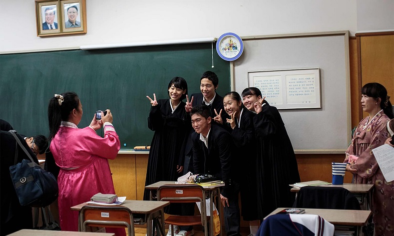 Hwang Song-Wi (centre) takes a picture with his classmates at Tokyo Korean high school.