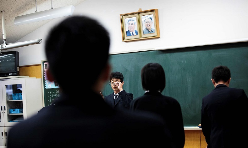 A teacher gestures after giving an exam to his students at Tokyo Korean high school.