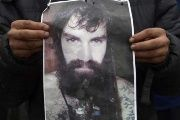 A person holds a poster of Santiago Maldonado during a march to demand justice.