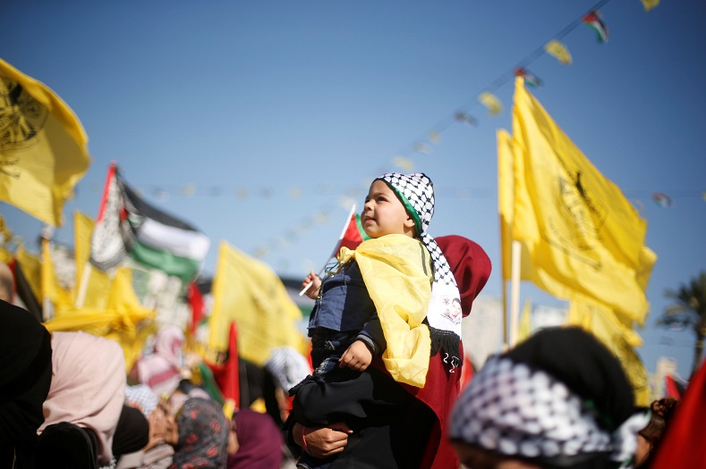Supporters of all ages pay tribute to Arafat in the Gaza Strip. Israel controls Gaza