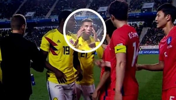 Cardona is seen making a racist gesture with his hands during the match against South Korea.