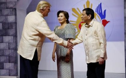 U.S. President Trump shakes hands with Philippines President Duterte as he arrives for the gala dinner in Manila, Philippines, Nov. 12, 2017.