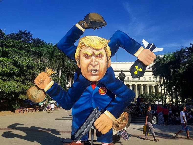 """The 13-foot Trump Effigy has rolled out in Manila. His four arms form a swastika sign, symbolizing fascism, war and plunder. Who"