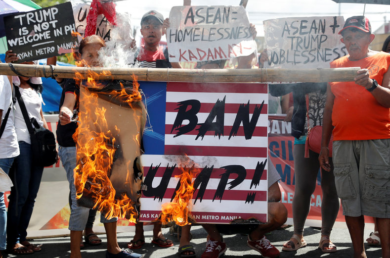 Protesters burn a mock U.S. flag to protest the visit of U.S. President Donald Trump to attend the ASEAN leaders summit in Manila, Philippines, November 7, 2017.