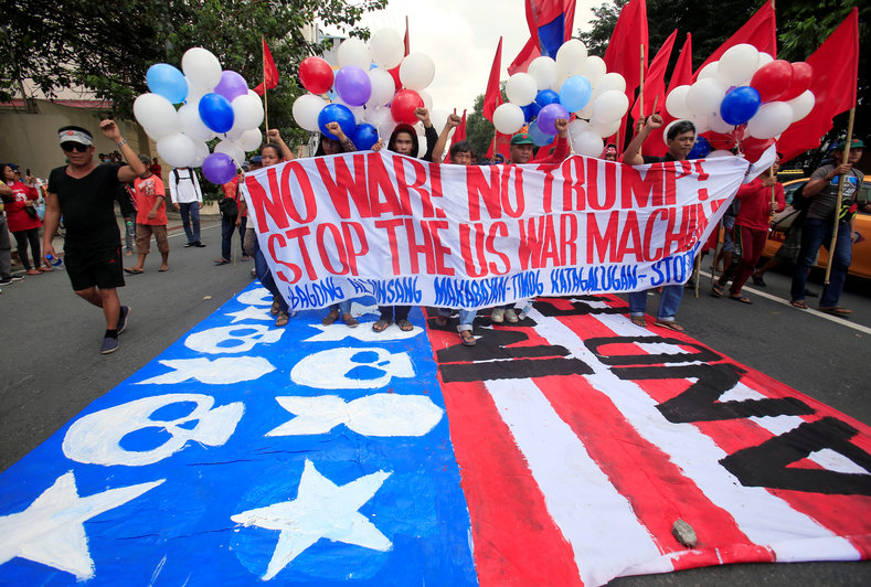 Protesters display a banner during a protest to denounce the visit of U.S. President Donald Trump, who will be attending the 31st Association of Southeast Asian Nations (ASEAN) leaders summit, in metro Manila, Philippines November 12, 2017.