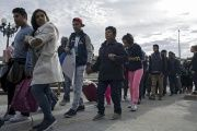 Migrants and supporters arrive at border to protest crimallization.