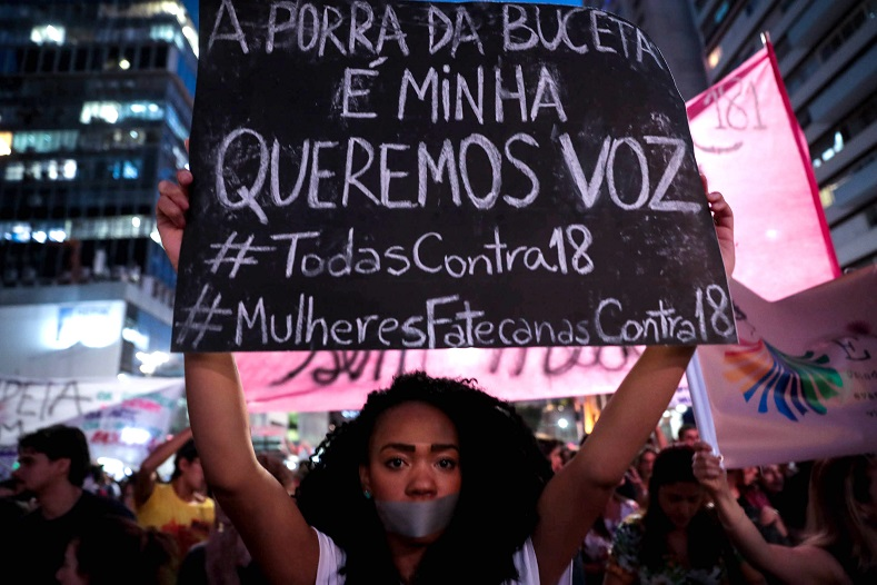 "A woman holds a sign that reads ""My vagina is mine, we want a voice"" during a demonstration in Sao Paulo."