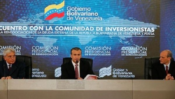 Venezuelan Vice President Tareck El Aissami presides over the refinancing meeting.