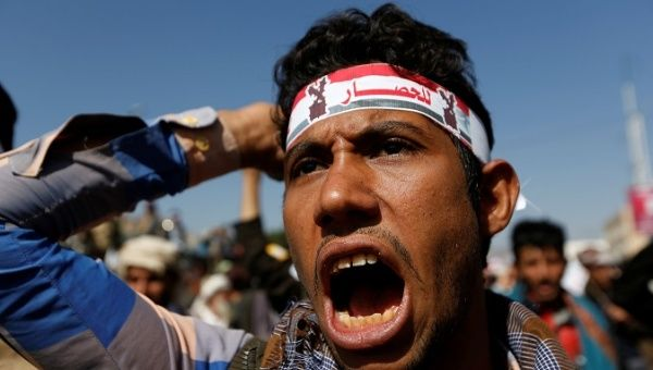 A supporter of the Houthi movement shouts slogans as he takes part in a demonstration against the closure of Yemen