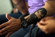 Sergio Maldonado, brother of Santiago, shows a tattoo of his brother during a news conference.