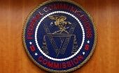 The Federal Communications Commission, FCC, logo is seen before the FCC Net Neutrality hearing in Washington February 26, 2015.