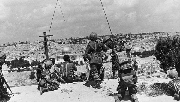 Israeli soldiers observe the compound known to Muslims as the Noble Sanctuary and to Jews as the Temple Mount, just prior to their attack on Jerusalem's Old City, during the 1967 war.