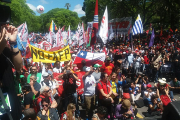 Protesters march against neoliberalism in Montevideo, Uruguay.