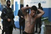 A suspected gang member is seen being arrested in Soyapango, El Salvador, March 31, 2016.