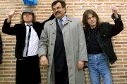 Angus and Malcolm (R) Young, founder members of AC/DC, flank the mayor of Leganes in Madrid following the inauguration of a new street with the group's name in 2000.