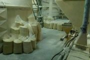 Bags of corn flour left to rot seen inside Demaseca's company plant in Venezuela.