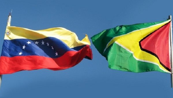 The flags of Venezuela and Guyana.