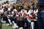 Houston Texans' Benardrick McKinney, Ben Heeney, Marcus Gilchrist and teammates kneel during the national anthem before kickoff against the Seattle Seahawks.