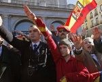 Supporters of Spain's late dictator Francisco Franco give fascist salutes.
