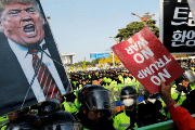 Protesters take part in an anti-Trump rally near the presidential Blue House in central Seoul, South Korea, during his visit