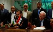 Leaders of Hamas and Al-Fatah delegations signing a reconciliation deal.