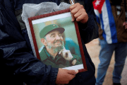 A supporter holds an image of former Cuban leader Fidel Castro at a tribute in Malaga, southern Spain, December 4, 2016.