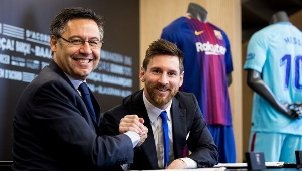 Messi poses with FC Barcelona president Josep Maria Bartomeu during the signing of his new contract in Barcelona