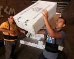 Workers load a truck with voting materials for further distribution throughout the country for the upcoming presidential election, in Tegucigalpa, Honduras November 20, 2017.