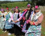 Female members of Argentina's Indigenous Mapuche community wearing traditional dress.