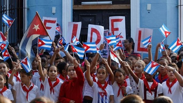 Schoolchildren commemorate the first anniversary of the death of Cuba