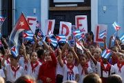 Schoolchildren commemorate the first anniversary of the death of Cuba's late president Fidel Castro in Havana.