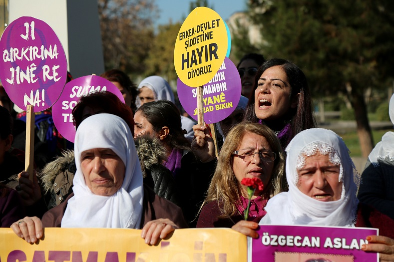 A demonstrator shouts slogans as she holds a placard during a gathering in Diyarbakir, Turkey.