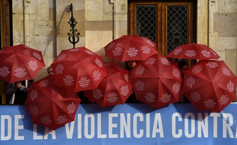 People display red umbrellas to commemorate the victims of gender violence during the UN International Day for the Elimination of Violence against Women rally in Oviedo, northern Spain.