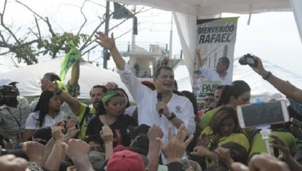 Former Ecuadorean President Rafael Correa speaks to welcomers.