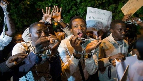 Protesters demonstrate against slavery in Libya.