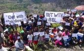 Local residents hold banners and placards during a protest at the former Bougainville Copper Limited