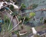 Toppled trees lie on a tennis court after Hurricane Maria battered St. Croix, U.S. Virgin Islands.