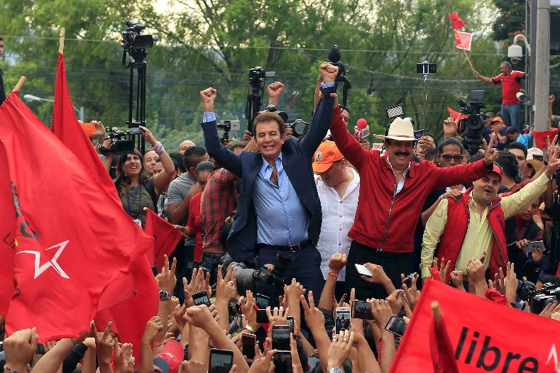 Nasralla celebrates with former president Manuel Zelaya, who backs the opposition alliance.