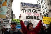 People participate in a protest march calling for human rights and dignity for immigrants, in Los Angeles, February 18, 2017