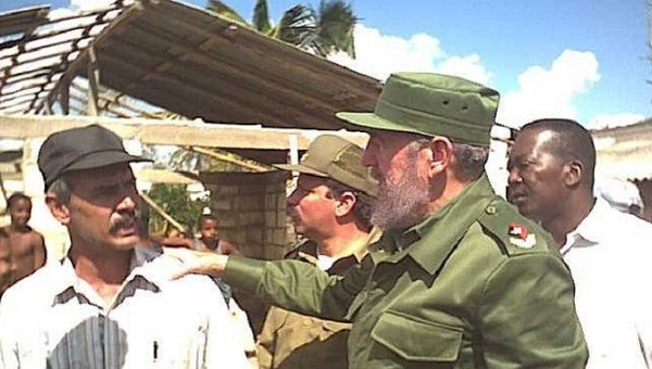 Cuban leader Fidel Castro with workers after Hurricane Ivan hit the island in 2004.