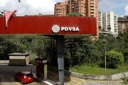The corporate logo of the state oil company PDVSA is seen at a gas station in Caracas, Venezuela November 16, 2017