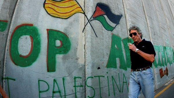 British rock star Roger Waters, of Pink Floyd, walks along the controversial Israeli barrier in the West Bank city of Bethlehem, 2006.