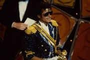 Michael Jackson pictured at the 26th annual Grammy Awards holding an award.