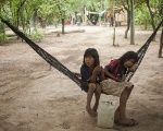 Two Indigenous Ayoreo Totobiegosode girls resting in the Chaidi community, in Alto Paraguay, December 2014.