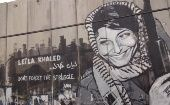 A mural depicting the famous photo of Leila Khaled in Bethlehem.